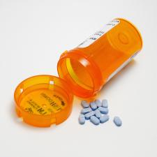 Prescription Bottle And Blue Pills